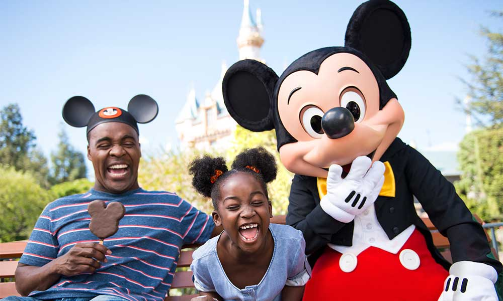 Family Enjoying Ice Cream With Cast Member In Mickey Mouse Costume