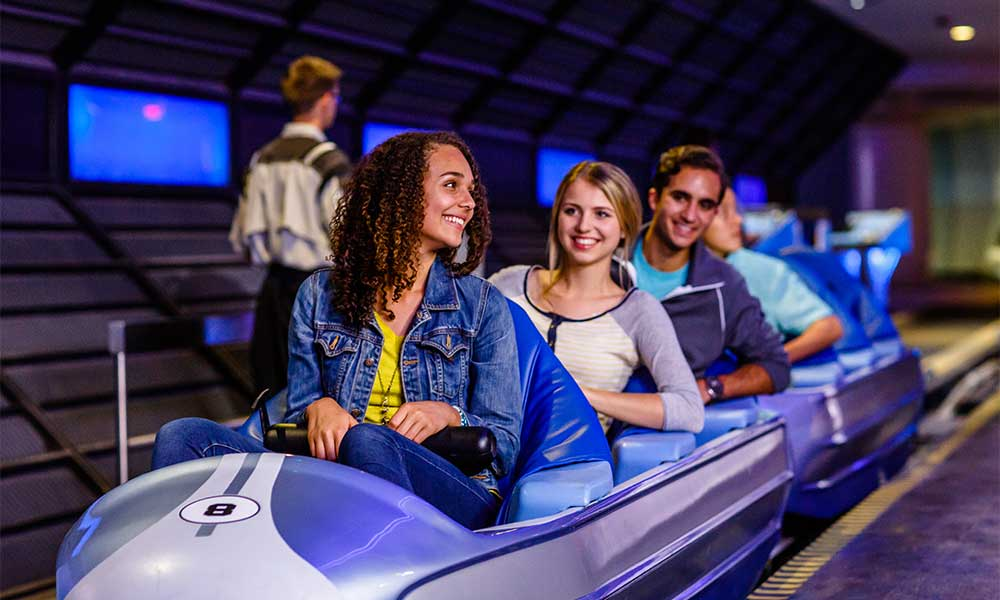 Teens Riding Space Mountain At Disney's Magic Kingdom©