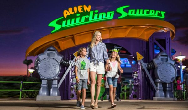 Family Walking Out Of Toy Story Land Swirling Saucers Ride At Walt Disney World ©Disney/Pixar