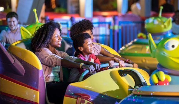 Family Riding Toy Story Land Swirling Saucers Ride At Walt Disney World ©Disney/Pixar